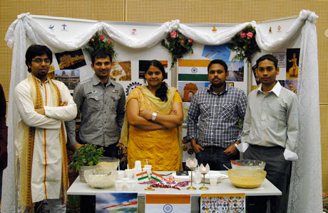 Students from India offering rice and spicy chicken at their stand.